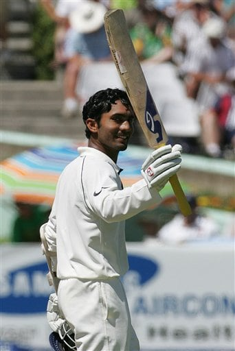 India's batsman Dinesh Karthik, celebrates his half century on the first day of the 3rd and final Test match against South Africa at Newlands stadium in Cape Town, South Africa, Tuesday.