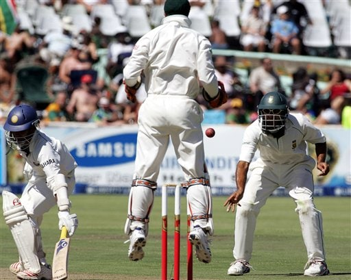 South Africa's fielder Hashim Amla, right, throws the ball after making a catch to dismiss India's batsman Dinesh Karthik, left, for 63 runs as teammate wicketkeeper Mark Boucher, center, celebrates on during the first day of the 3rd and final Test match against India at Newlands stadium in Cape Town, South Africa, Tuesday.