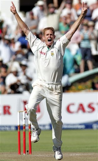 South Africa's bowler Shaun Pollock, celebrates the dismissal of India's batsman Rahul Dravid, unseen, for 29 runs on the first day of the 3rd and final Test match against India at Newlands stadium in Cape Town, South Africa, Tuesday.
