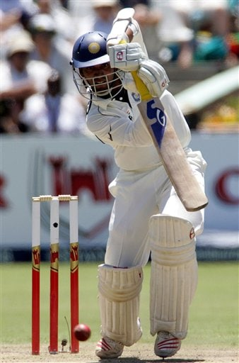 India's batsman Dinesh Karthik, watches his shot on the first day of the 3rd and final Test match against South Africa at Newlands stadium in Cape Town, South Africa, Tuesday.