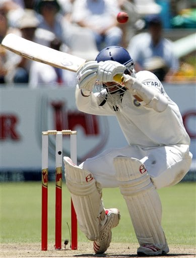 India's batsman Dinesh Karthik ducks under a bouncer on the first day of the 3rd and final Test cricket match against South Africa at Newlands stadium in Cape Town, South Africa, Tuesday.
