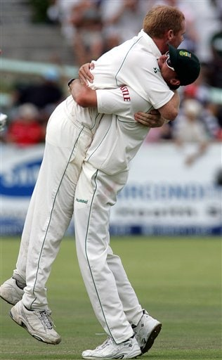 South Africa's bowler Shaun Pollock, left, celebrates with teammate Dale Steyn, right, after dismissing India's batsman Sourav Ganguly, unseen, on the second day of the 3rd and final Test match against India at Newlands stadium in Cape Town, South Africa, Wednesday.