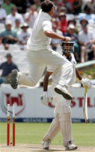India's batsman VVS Laxman, right, leaves the crease after being bowled by South Africa's Dale Steyn, left, for 13 runs on the second day of the 3rd and final Test match against South Africa at Newlands stadium in Cape Town, South Africa, Wednesday.