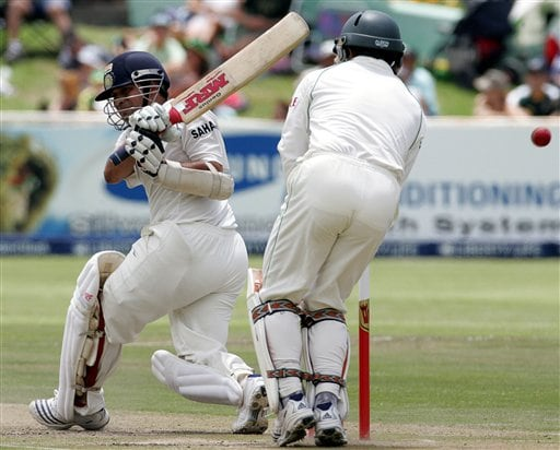 India's batsman Sachin Tendulkar, left, in action as South Africa's wicketkeeper Mark Boucher, right, looks on during the second day of the 3rd and final Test match against South Africa at Newlands stadium in Cape Town, South Africa, Wednesday.