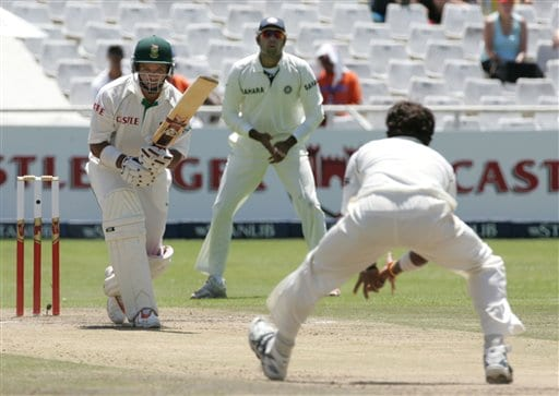 South Africa's batsman Ashwell Prince, left, looks on as India's bowler Shanthakumaran Sreesanth, right, fields off his own bowling whilst teammate VVS Laxman, center, watches on the third day of the 3rd and final Test match against India at Newlands stadium in Cape Town, South Africa, Thursday.