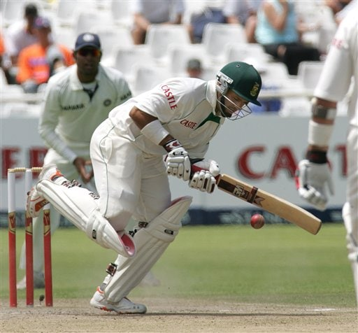 South Africa's batsman Ashwell Prince, right, in action as India's fielder VVS Laxman, left, looks on during the third day of the 3rd and final Test match against India at Newlands stadium in Cape Town, South Africa, Thursday.