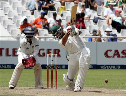 South Africa's batsman Jacques Kallis, right, plays a stroke as India's wicketkeeper Dinesh Karthik, left, looks on during the third day of the 3rd and final Test match against India at Newlands stadium in Cape Town, South Africa, Thursday.