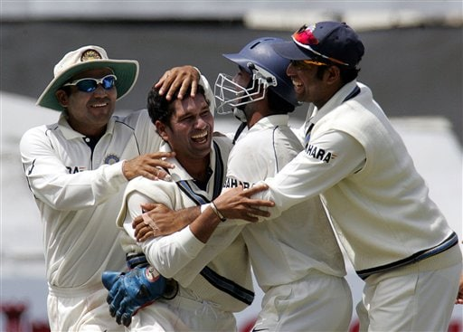 India's bowler Sachin Tendulkar, second from left, celebrates with teammates Virender Sehwag, left, wicketkeeper Dinesh Karthik, second from right, and VVS Laxman, right, after dismissing South Africa's batsman Jacques Kallis, unseen, for 54 on the third day of the 3rd and final Test match against South Africa at Newlands stadium in Cape Town, South Africa, Thursday.
