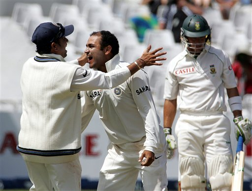 India's bowler Virender Sehwag, center, celebrates with teammate Sachin Tendulkar, left, after dismissing South Africa's batsman Herschelle Gibbs, right, for 7 runs after a successfully appeal for a LBW on the third day of the 3rd and final Test match against South Africa at Newlands stadium in Cape Town, South Africa, Thursday.