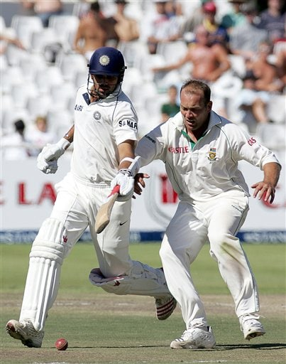India's batsman Zaheer Khan, left, raises his bat near the ball as South Africa's bowler Jacques Kallis, right, attempts to field as he makes a run on during the fourth day of the 3rd and final Test match against South Africa at Newlands stadium in Cape Town, South Africa, Friday.