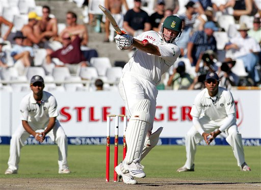 South Africa's batsman Graeme Smith, center, misplays a shot as India's fielders Sourav Ganguly, left, and VVS Laxman, right, looks on during the fourth day of the 3rd and final Test match against India at Newlands stadium in Cape Town, South Africa, Friday.
