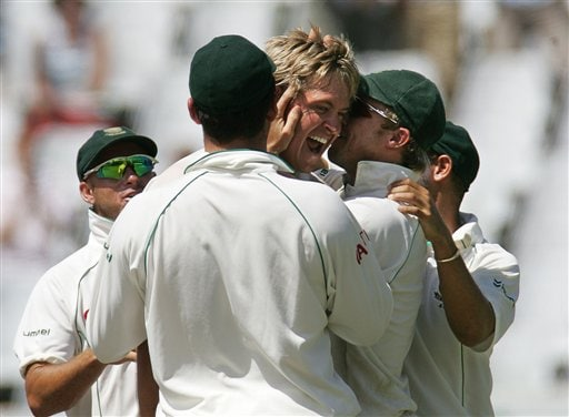South Africa's bowler Paul Harris, center, celebrates with teammates after dismissing India's batsman Rahul Dravid, unseen, for 47 runs on the fourth day of the 3rd and final Test match against India at Newlands stadium in Cape Town, South Africa, Friday.