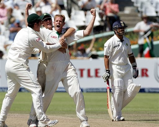 South Africa's bowler Shaun Pollock, second from right, celebrates with teammates captain Graeme Smith, left, and AB de Villiers, second from left, after a successfully appeal for a LBW to dismiss India's batsman Sachin Tendulkar, right, for 14 runs on the fourth day of the 3rd and final Test match against India at Newlands stadium in Cape Town, South Africa, Friday.