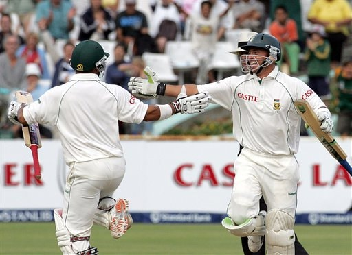 South Africa's batsman Ashwell Prince, left, celebrates with teammate Herschelle Gibbs, right, as he scores the winning runs on the final day of the 3rd and final Test match against India at Newlands stadium in Cape Town