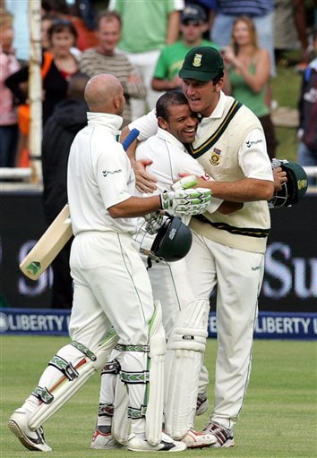 South Africa's captain Graeme Smith, right, congratulates teammates batsman Ashwell Prince, center, and Herschelle Gibbs, after scoring the winning runs on the final day of the 3rd and final Test match against India at Newlands stadium in Cape Town