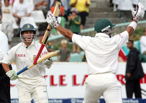 South Africa's batsman Ashwell Prince, right, celebrates with teammate Herschelle Gibbs, as he scores the winning runs on the final day of the 3rd and final Test match against India at Newlands stadium in Cape Town