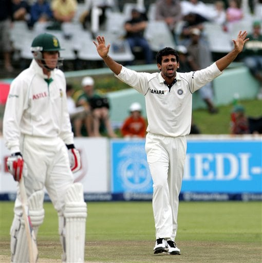 India's bowler Zaheer Khan, right, appeals unsuccessfully for LBW against South Africa's batsman Shaun Pollock, left, on the final day of the 3rd and final Test match at Newlands stadium in Cape Town