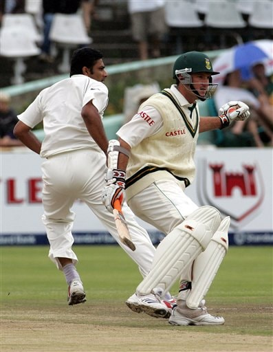 South Africa's batsman Graeme Smith, right, runs back after attempting a run as India's bowler Anil Kumble, left, calls for the ball on the final day of the 3rd and final Test match at Newlands stadium in Cape Town