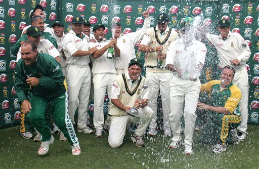 South Africa's cricket team celebrates after winning by 5 wickets the 3rd test and the series against India at Newlands stadium in Cape Town