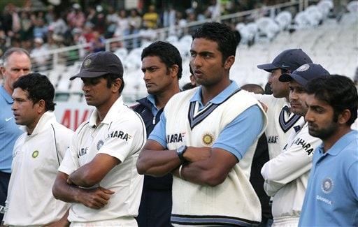 India's dejected cricket team looks on during the winners presentation after loosing by 5 wickets the 3rd test and the series against South Africa at Newlands stadium in Cape Town