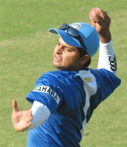 Indian cricketer Suresh Raina throws the ball during practice session in Nagpur.