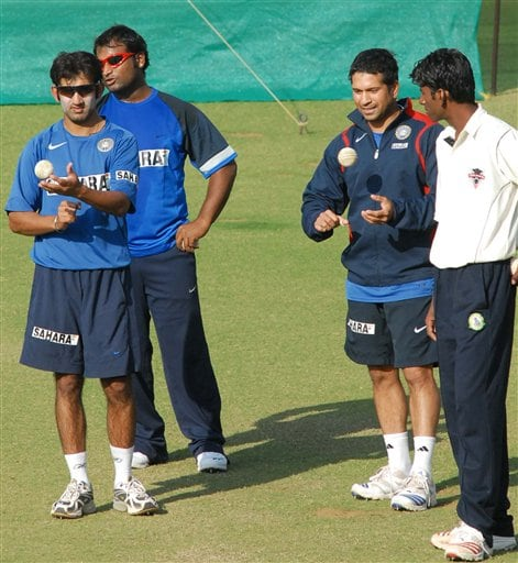 Indian cricketers Gautam Gambhir, left, Ramesh Powar, second left, and Sachin Tendulkar, second right, look on during a practice session in Nagpur.
