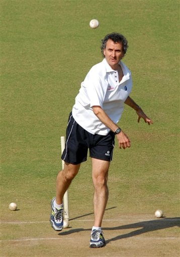Umpire Billy Bowden bowls in the nets in Nagpur.