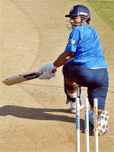 Indian cricketer Robin Utthappa bats during a practice session in Nagpur.
