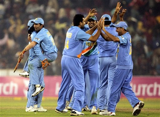 Indian cricketers celebrate their victory over West Indies in the second one-day international cricket match in Cuttack, India, Wednesday.
