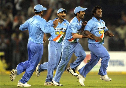 Indian cricketers Ramesh Powar, right, Dinesh karthik, second right, Joginder Sharma, third right, and Rahul Dravid celebrate the dismissal of West Indies Dwayne Bravo, unseen, during the second one day international cricket match in Cuttack.