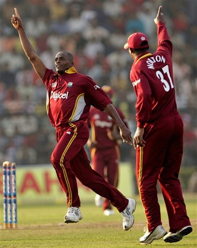 West Indies' cricketer Daren Powell, left, and Runako Morton celebrate the dismissal of India's Joginder Sharma, unseen, during the second one-day international cricket match in Cuttack.