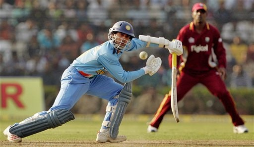Indian cricketer Dinesk Karthik plays a shot against West Indies during the second one-day international cricket match in Cuttack.