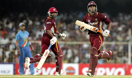 West Indies cricketers Marlon Samuels, right, and Brian Lara, center, complete their run as India's S. Sreesanth, looks on during the third one-day international cricket match in Chennai, India, Saturday, January 27, 2007.