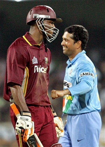 Indian cricketer Sachin Tendulkar, right, playfully punches West Indies cricketer Marlon Samuels after Samuels played a shot during the third one-day international cricket match in Chennai, India, Saturday, January 27, 2007.