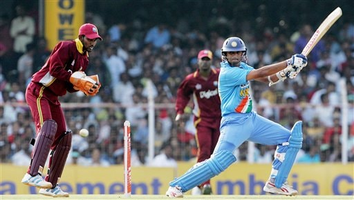 Indian cricketer Rahul Dravid, right, plays a shot as West Indies wicket keeper Denesh Ramdin looks on during the third one-day international cricket match in Chennai, India, Saturday, January 27, 2007.