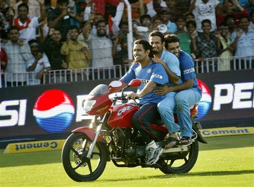 Indian cricketers Mahendra Singh Dhoni, left, Irfan Pathan, center, and Robin Uthappa ride a bike in joy after India beat West Indies in the fourth one-day international cricket match in Vadodara, India.