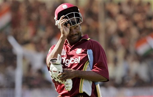 West Indies Brian Lara removes his helmet while leaving the ground after India's Irfan Pathan took his wicket during the fourth one day international cricket match in Vadodara, India.