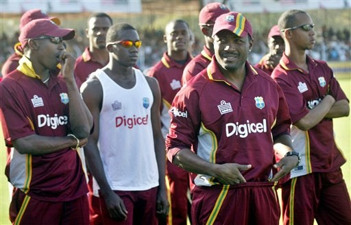 West Indies cricket players attend a presentation ceremony after the fourth one-day international cricket match against India in Vadodara, India.