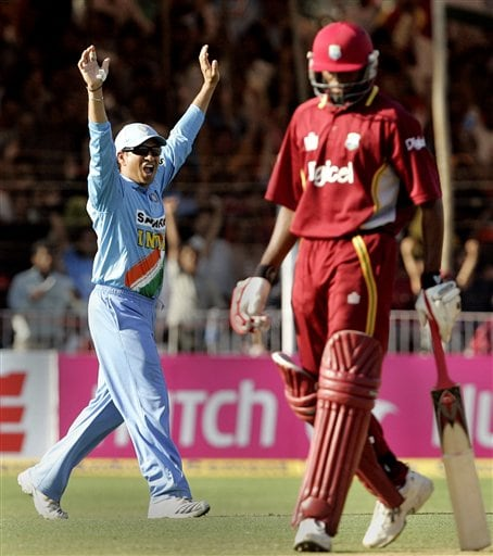 Indian cricketer Sachin Tendulkar, left, celebrates after winning the fourth one-day international cricket match against West Indies in Vadodara, India.
