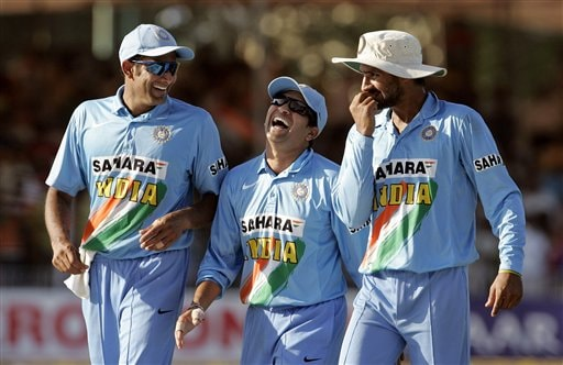 Indian cricketers Sachin Tendulkar, center, Anil Kumble, left and Harbhajan Singh celebrate their team's victory over West Indies during the fourth one-day international cricket match in Vadodara, India.
