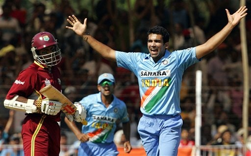 India's Zaheer Khan, right and Rahul Dravid, center, celebrate the dismissal of West Indies Shivnaraine Chanderpaul, left during the fourth one day international cricket match in Vadodara, India.