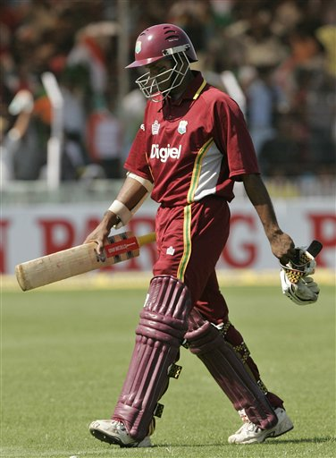 West Indies batsman Shivnaraine Chanderpaul leaves the ground after his dismissal by India's Zaheer Khan during the fourth one day international cricket match in Vadodara, India.