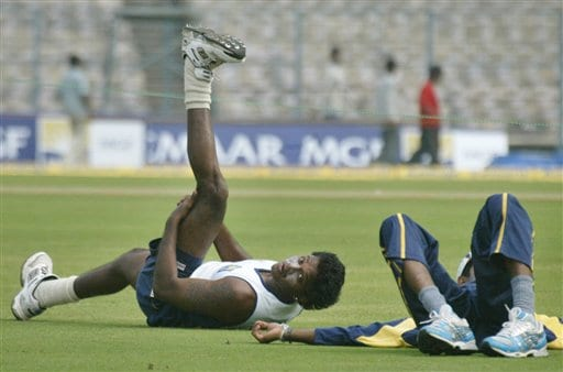 Sri Lanka's Dilhara Fernando, left, stretches during a practice session in Kolkata, India, Wednesday, February 7, 2007. Sri Lanka will play its first one day limited over international cricket match against India Thursday.