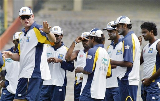 Sri Lanka cricket coach Tom Moody, left, directs his players during a net practice session in Kolkata, India, Wednesday, Feb. 7, 2007.