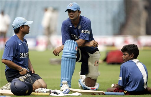 India's Sachin Tendulkar, left and Rahul Dravid, center share a moment during a practice session a day before the first one day international cricket match against Sri Lanka in Kolkata, India Wednesday, February 7, 2007.