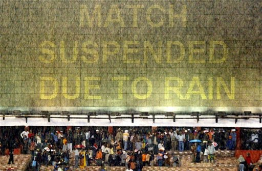 A message flashes on the scoreboard as rain falls over the Eden Gardens stadium during the first one-day international cricket match between India and Sri Lanka in Kolkata on Thursday, February 8, 2007.