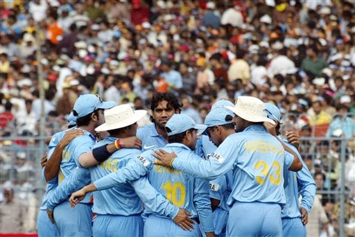 Indian cricketers huddle after the dismissal of Sri Lanka captain Mahela Jayawardene, unseen, by Indian bowler Munaf Patel, center back row, for no runs during the first one-day international match in Kolkata on Thursday, February 8, 2007.