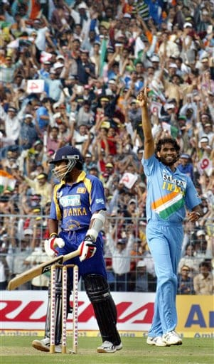 Sri Lanka captain Mahela Jayawardane, left, walks back to the pavilion after being dismissed by Indian bowler Munaf Patel for no runs during the first one-day international match in Kolkata on Thursday, February 8, 2007.