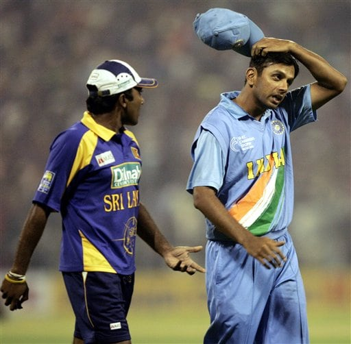 India's Rahul Dravid, second right, and Sri Lanka'a Mahela Jayawardena, fourth right, leave the ground after the first one-day international match was called off due to rains, in Kolkata on Thursday, February 8, 2007.