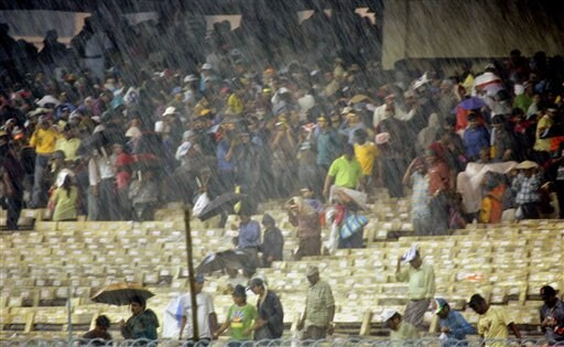 Rain falls over the Eden Gardens stadium during the first one-day international cricket match between India and Sri Lanka in Kolkata on Thursday, February 8, 2007.